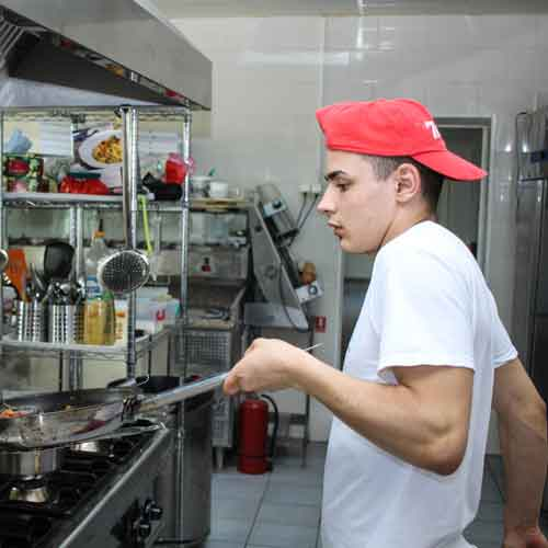 Young man working in a kitchen